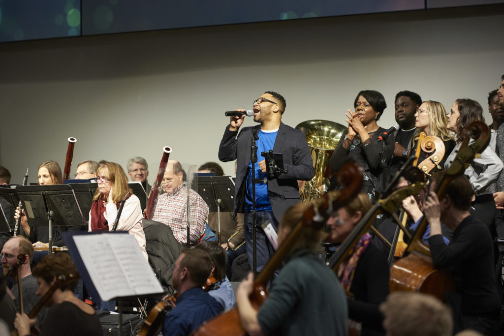 Joseph Garnier and Sanctuary Covenant Choir lead songs with Minnesota Orchestra.